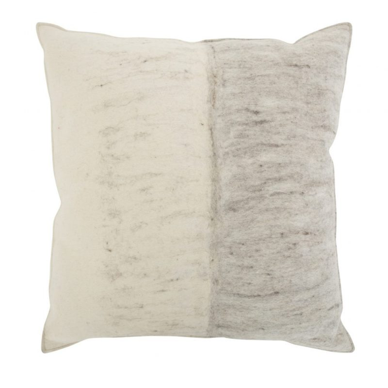 Doris is a hand felted wool pillow. Made in Nepal by skilled women felters, each pillow is one-of-a-kind. Heritage techniques from centuries ago are applied to the finest undyed sheep's wool for a natural splendorous effect. Perfect to rest your head on in style and let your mind wander.