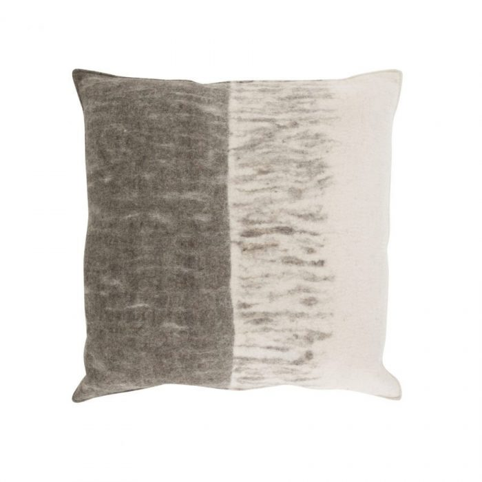 Duke is a hand felted wool pillow. Original and made by hand in Nepal by skilled women felters. Art for the home from the finest undyed sheep's wool. Traditional craftsmanship at its best, suited to today's tastes.