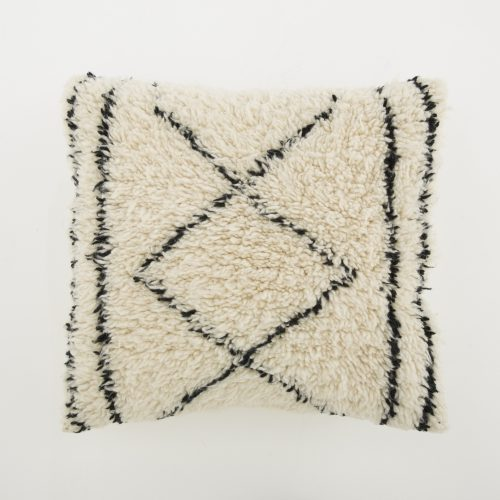 Frances is a Beni Ourain pillow. Hand knotted in Morocco's Atlas mountains by skilled women weavers, each pillow is a work of art, showcasing the finest sheep's wool and featuring heritage techniques from as long ago as the Neolithic Era. With its lush soft piles it is taking comfort and style to a new level.